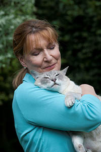 Margrit Coates hugging teddy the cat
